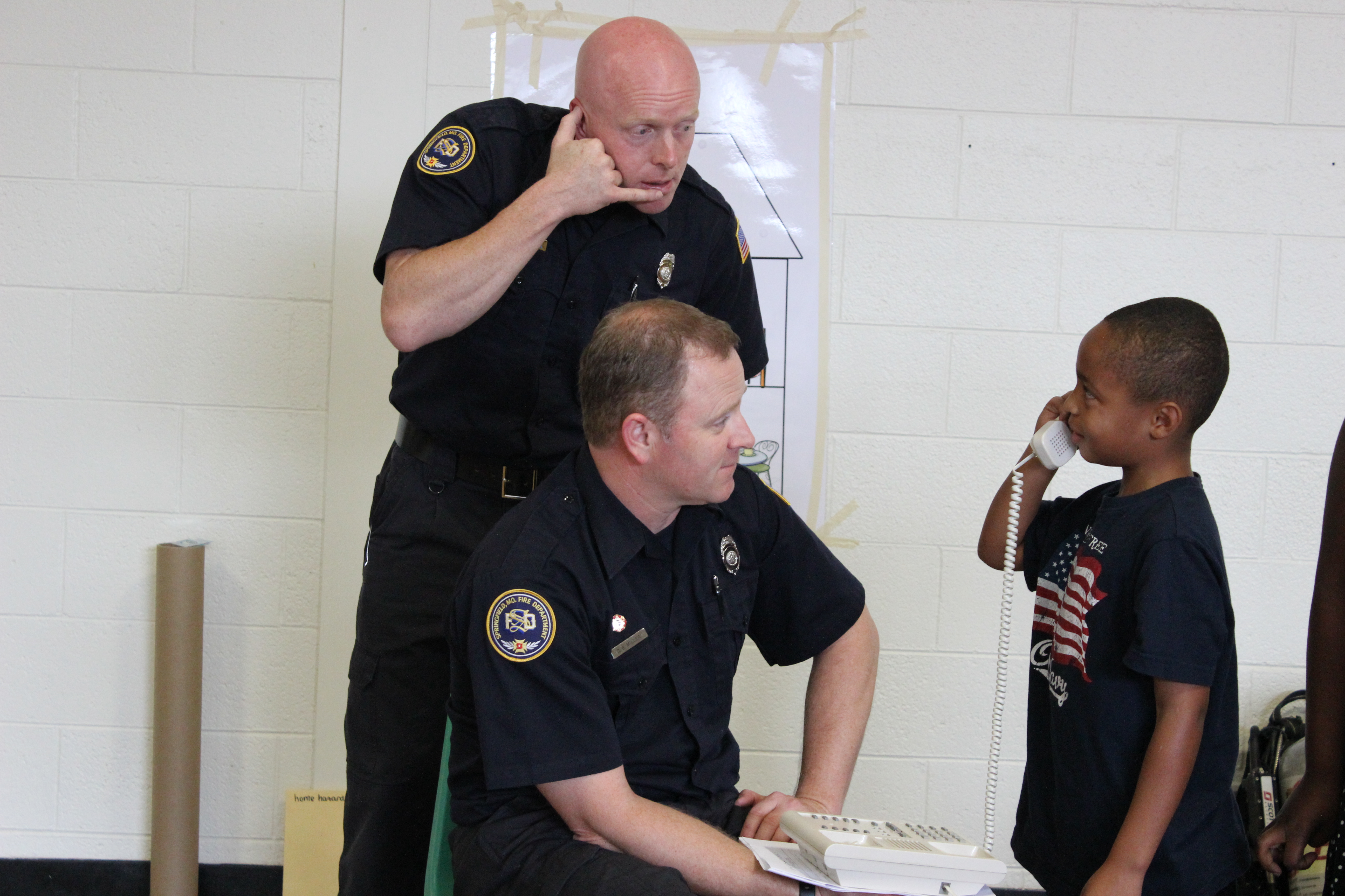 Firefighters educating boy