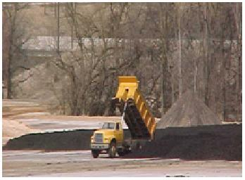 A dump truck deposits biosolids at the plant to wait for use as fertilizer.