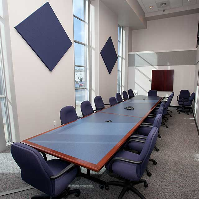 long, narrow conference room with long table in the middle
