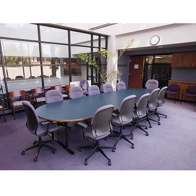 sunny conference room with large outside wall of glass